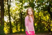 Portrait of a cute little girl of 7 years old in the park — Stock Photo