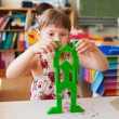 Cute little girl working in a classroom — Stock Photo #75733427