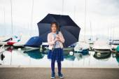 Outdoor portrait of adorable little girl with umbrella — Stock Photo