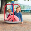 Cute kids, schoolgirl and her little brother having fun on playground — Stock Photo #81153574