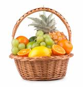 Ripe fresh fruits in a basket — Stock Photo