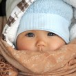 Baby in warm clothes in cold weather — Stock Photo #53385315