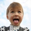 Boy with tongue hanging out screaming — Stock Photo #54199365