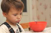 Sad boy refusing to eat — Stock Photo