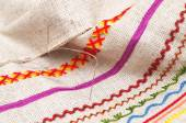 Needle on fabric with embroidery — Stock Photo