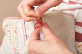 Sewing with floss needle and thread — Stock Photo