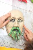 Plasticine face with moustache sculpting — Stock Photo