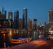 Dubai Marina at Blue hour, Glittering lights and tallest skyscrapers during a clear evening with Blue sky. — Stock Photo