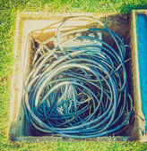 Retro look Wires in manhole — Stock Photo