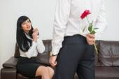 Businessman  hiding a flower  for his colleague — ストック写真