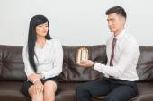 Business couple sitting on sofa in office — Stock Photo