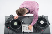 Top view portrait of dj mixing and spinning turntable — Stock Photo