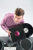Top view portrait of dj showing his vinyl records standing by tu — Stock Photo