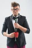 MC putting microphone into the cup — Stock Photo