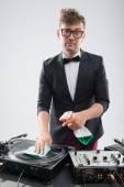 DJ in tuxedo cleaning his turntable — Stock Photo