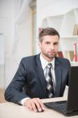 Businessman working with laptop — Stock Photo