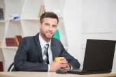 Businessman enjoying the coffee-break — Stock Photo