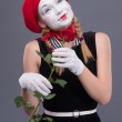 Portrait of female mime with red hat and white face grimacing wi — Stock Photo #53226823