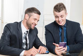 Waist-up portrait of two handsome businessmen in suits — Stock Photo