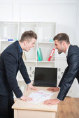 Two angry businessmen near the table — Stock Photo