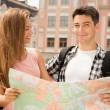 Couple of tourists holding a map — Stock Photo #54229915