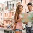 Couple of tourists holding a map — Stock Photo #54229945