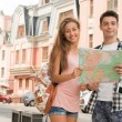 Couple of tourists holding a map — Stock Photo #54229949