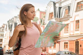 Female traveler viewing the map — Stock Photo
