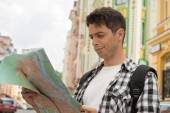 Male traveler looking at the map — Stock Photo