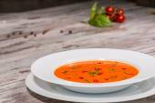 Picture of cold tasty tomato soup gazpacho with species on the w — Stockfoto