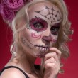 Portrait of young blond girl with Calaveras makeup and a rose fl — Photo #55208629