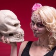 Portrait of young blond girl with Calaveras makeup and a rose fl — Foto de Stock   #55208659
