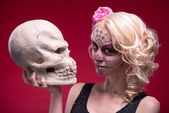 Portrait of young blond girl with Calaveras makeup and a rose fl — Stock Photo