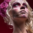 Portrait of young blond girl with Calaveras makeup and a rose fl — Photo #55299919