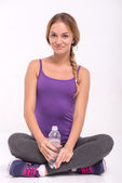Healthy young sportswoman does the exercises — Stock Photo