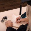 Student girl writing with ink and feather — Stock Photo #60584161