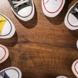 Multicolored youth gym shoes on floor — Stock Photo #60649429