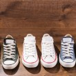 Multicolored youth gym shoes on floor — Stock Photo #60649483