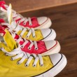 Multicolored youth gym shoes on floor — Stock Photo #60650319