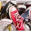 Multicolored youth gym shoes on floor — Stock Photo #60650421