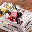 Multicolored youth gym shoes on floor — Stock Photo #60650451