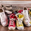 Multicolored youth gym shoes on floor — Stock Photo #60650509