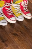 Multicolored youth gym shoes on floor — Foto de Stock