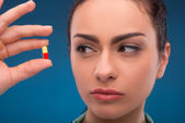 Woman doctor holding pill — Stock Photo