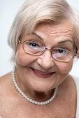 Closeup of lovely elderly woman — Stock Photo