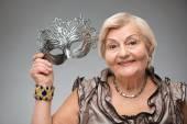 Elderly woman wearing glamorous mask — Fotografia Stock