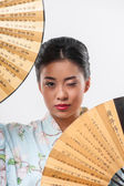 Japanese woman with traditional fan — Stock Photo
