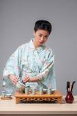 Asian beauty getting ready for tea ceremony — Stock Photo