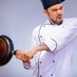 Portrait of young handsome cook — Stock Photo #64496505
