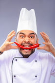 Portrait of young handsome cook — Stock Photo